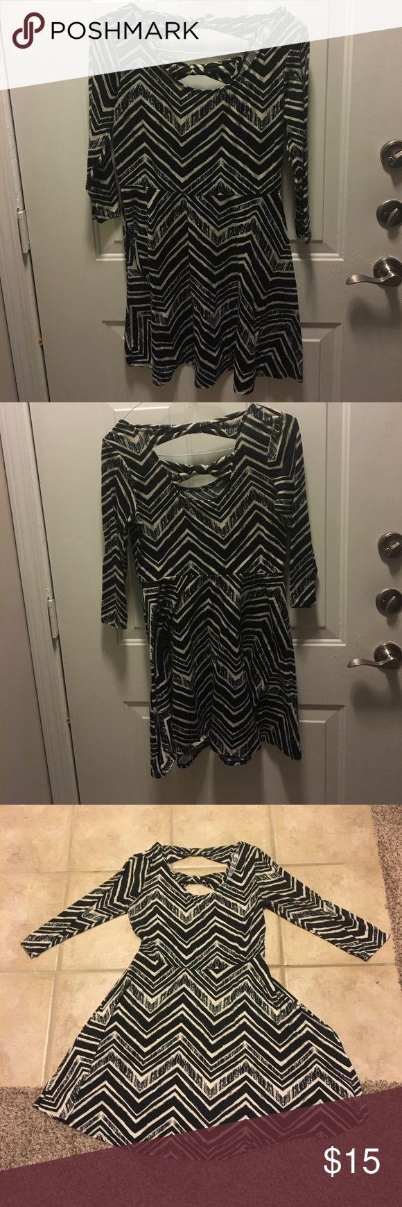 Xhilaration black and white dress! Fits M or L. Black and white chevron pattern. Back has openings that are very flattering. Summer night or winter dress. Good for all seasons! Xhilaration Dresses Mini
