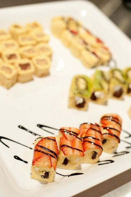 A plate of dessert sushi made using only Little Debbie snacks and fresh fruit.
