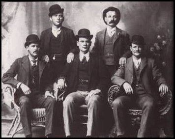 Robert Parker, 34 (seated near left) went by Butch Cassidy. Harry Longbaugh, 30 (seated far left), went by Sundance Kid. Their Wyoming-based Hole in the Wall gang of robbers and rustlers was also called the The Wild Bunch (but that's another movie). Butch and Sundance did flee to Bolivia in 1901. But where did they die? Butch near Spokane in 1937, claim some, and Sundance in Casper, Wyoming, circa 1957.: Forts Worth Texas, Tall Texans, Wild Bunch, Wildbunch, Kids Curries, Sundanc Kids, Butches Cassidy, Photo, Wild West
