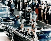 November 22, 1963 - In Dallas, Texas, during a motorcade through downtown, President John F. Kennedy is mortally wounded by assassin Lee Harvey Oswald. Vice President Lyndon B. Johnson is sworn into office later that day. Two days later, Oswald was himself killed on live national television by Jack Ruby while being transported in police custody.
