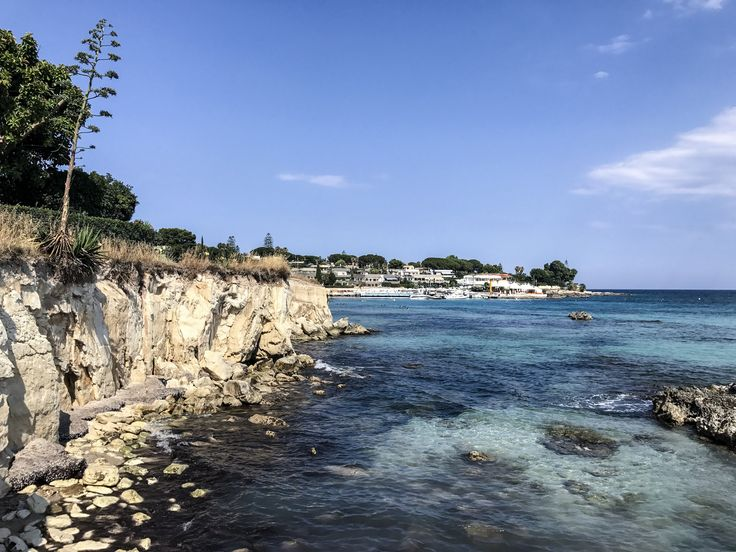Fontane Bianche - a beach at half an hour from Syracuse. Try the bus. It's only 1 euro.