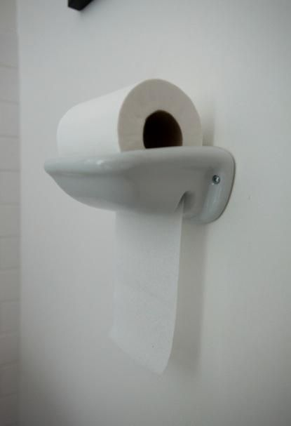 The man's toilet paper holder!  Just drop and pull!