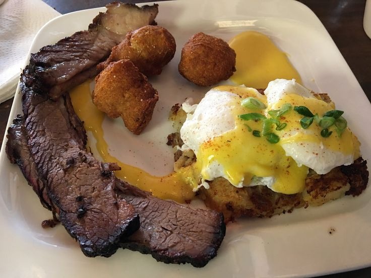 Eggs hollandaise with hush puppies and brisket Foodspotting at Greenwood Smokehouse BBQ