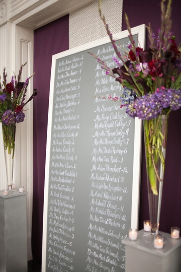 another way to use chalkboards    calligraphy seating chart from a wedding planned by A Charleston Bride