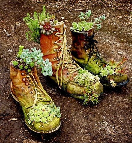 great recycling; these old boots become lovely flower pots! :)