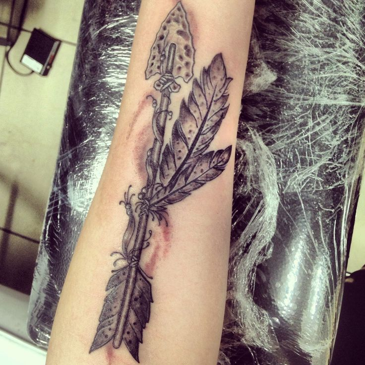 Old school style Indian Arrow tattoo. Done by Ayden Hinton at Palace of Pain - Cleveland, Brisbane.