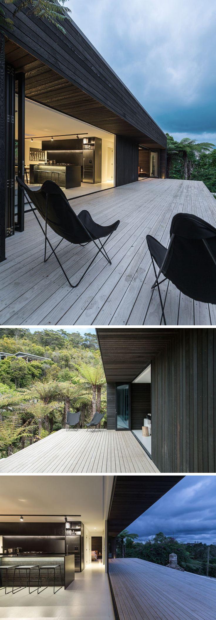Lake thomas point transitional exterior - The Dark Wood Exterior Of This House Flows Through To The Interior