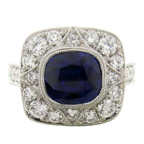 THE ROBIN RING  A custom design blue sapphire and diamond ring. (R641)