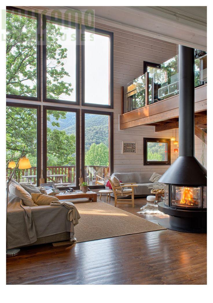 #salón casa de madera Kuusamo Log Houses en la provincia de Barcelona. Obra de House Habitat