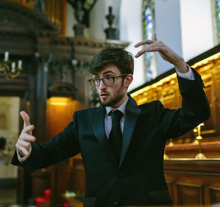Conducting Univ Choir in the chapel.
