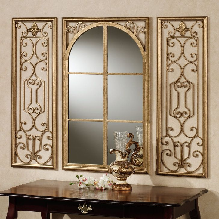 Interior. curving mirror with golden bars and carving golden ornaments placed on the cream wall. Marvelous Large Decorative Wall Mirrors Offer Luxurious Look Of Your House