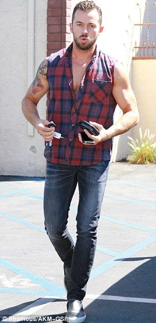No flux capacitor needed!: Evergreen Lea Thompson, 53, (left) looked good in an almost entire black ensemble as her partner Artem Chigvintsev (right) arrived in a sleeveless, checked flannel
