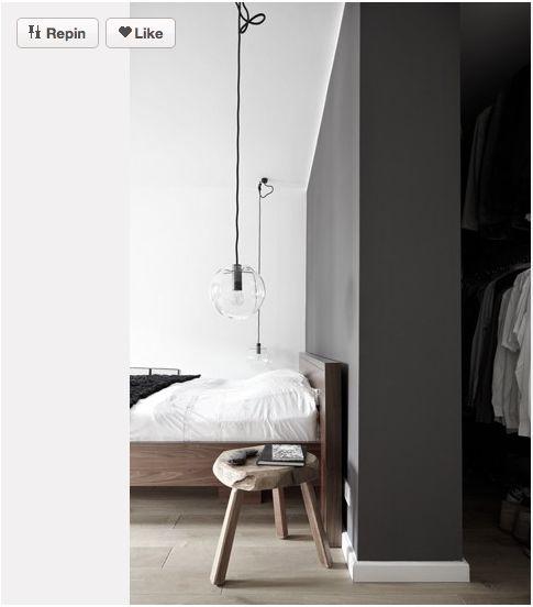Wardrobe behind bed