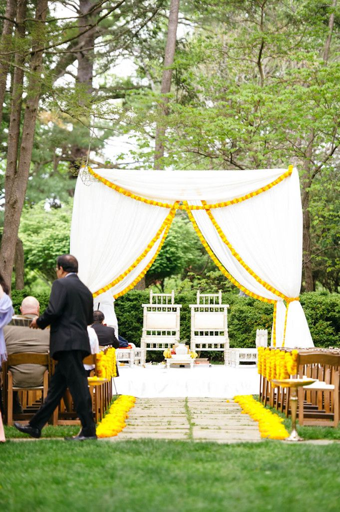Simple white and marigold outdoor mandap idea, great for a fusion wedding mandap