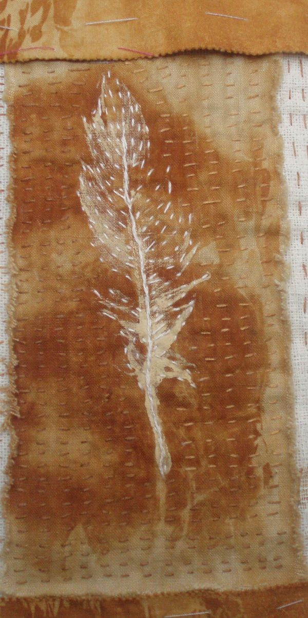 rust dyed cotton with feather resist, Kantha stitched