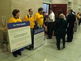 Hundreds of workers are gathered in the hallway outside the House Liquor Committee Hearings at the Capitol today, demonstrating their opposition to Governor Corbett's Wine and Spirits privatization scheme.The labor movement, along with groups supporting public health and safety, oppose privatization of the PA Wine and Spirits stores which would eliminate 5,000 good jobs and end up costing Pennsylvania taxpayers over $500 million in annual revenues.