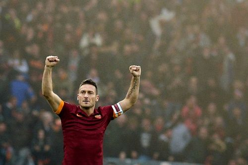 Roma legend Totti makes a young fan freak out