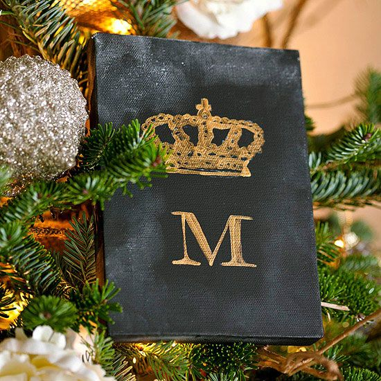 Family Initial Ornament~Display your family's initial with this easy, elegant ornament. Paint a piece of mini artist's canvas black. Using stamps and a gold stamp pad, stamp a gold crown or other image and your family's surname initial, let dry, then rub the surface with chalk. Set the canvas on top of a sturdy tree branch or add a hanging loop to the back.