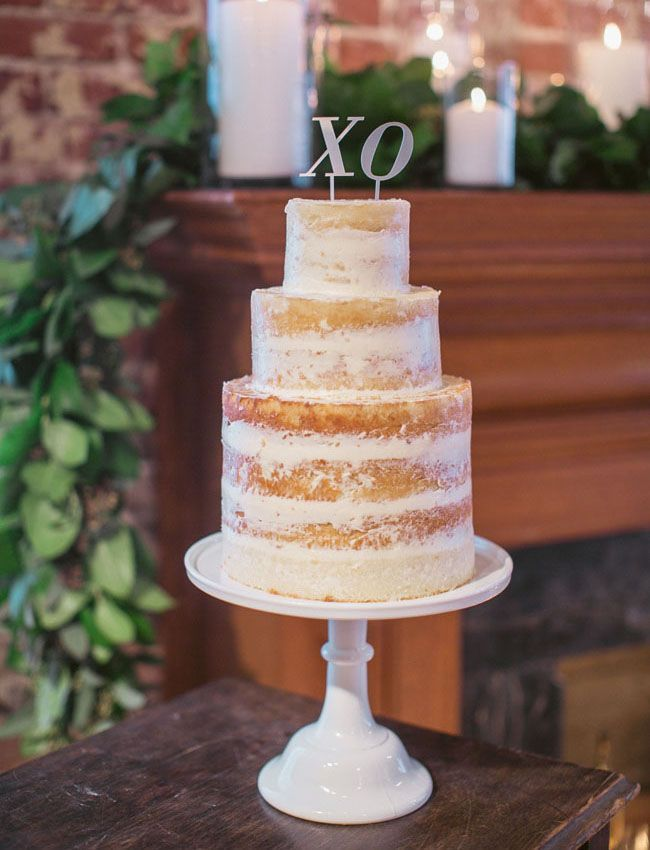 Modern Nearly Naked Wedding Cake With XO Topper : http://www.fabmood.com/24-semi-naked-wedding-cakes-with-pretty-details/