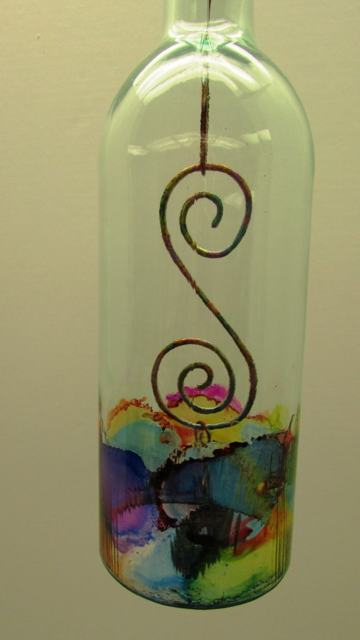 Used alcohol inks on the wire, the washer and the glass. Sealed the wire and washer with clear lacquer and the glass is sealed with mod podge gloss. The alcohol inks are on the inside of the glass. Not sure how well this would hold up outside for a wind chime but the color would make it a great sun catcher. Made by Karen Bennett 3/2014.