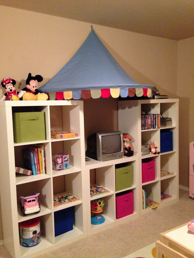 Playroom shelving. Expedit shelves and awning from Ikea. Storage bins from Target.