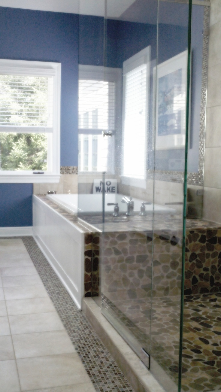 Rock tiles for bathroom - Bathroom With A Big Tub In A River Rock Tile Deck And Heavy Glass Shower