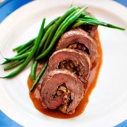 Steak Roulade w/ Caramelized Onions, Bacon, & Goat Cheese.  Served w/ Sauce Brune