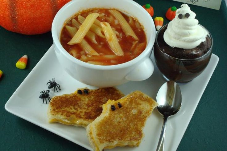 Halloween Meal - Tomato soup with pasta bones, grilled cheese bats, and chocolate pudding with whipped cream ghosts.