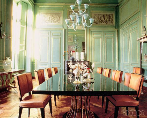 In a Paris dining room decorated by antiques dealers Françoise and Yves Gastou, mint walls and a lacquered green dining table provide a chic contrast to orange leather chairs.