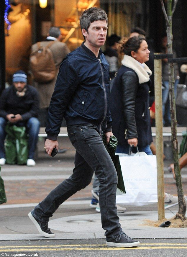 Final Christmas splurge: Noel Gallagher was pictured leaving London's famous Harrods in Lo...