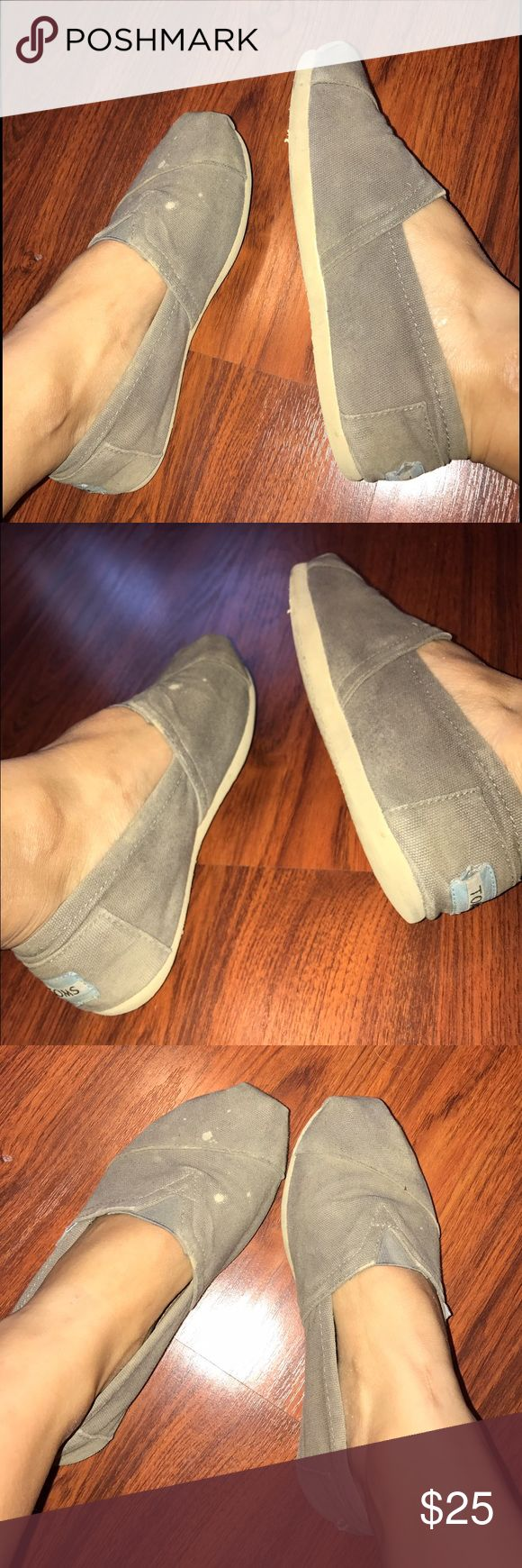 Gray TOMS Good condition, worn. Has a few bleach splash marks on the left shoe. Extremely comfortable and perfect with any attire. TOMS Shoes Flats & Loafers