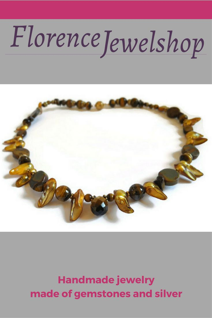 The necklace is made of pearls, tiger eye and vermeil elements finished with a magnetic clasp. This pearl and tiger eye necklace is not an �old fashioned� necklace: the ones you probably know with the round pearl and in the color white. This necklace is made of blister pearls: the pearl is in the mother of pearl �cage� and therefore very special. The tiger eye beads have different shapes (round, briolette, oval) and there are polished (shiny) and unpolished beads in the necklace.