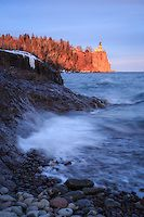 """""""Golden Hour at Split Rock Lighthouse""""<br /> As the sun sank toward the horizon, Split Rock Lighthouse was bathed in its magic light, while gentle waves lapped at Lake Superior's shores. Just a short drive up the shore from Duluth, Minnesota, Split Rock Lighthouse State Park is a favorite destination for many visitors and locals. Set atop a 130 foot (40 m) cliff on Lake Superior, the elevation of the light is 168 feet (51 m), and was visible from 25 miles (40 km) or more. The Fresnel lens…"""