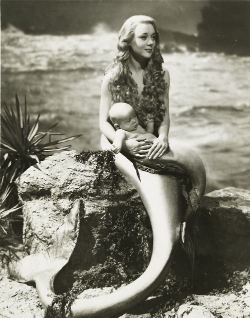 such a beautiful picture!!!!! I love the baby mermaid. The photo is from the 1948 film Miranda