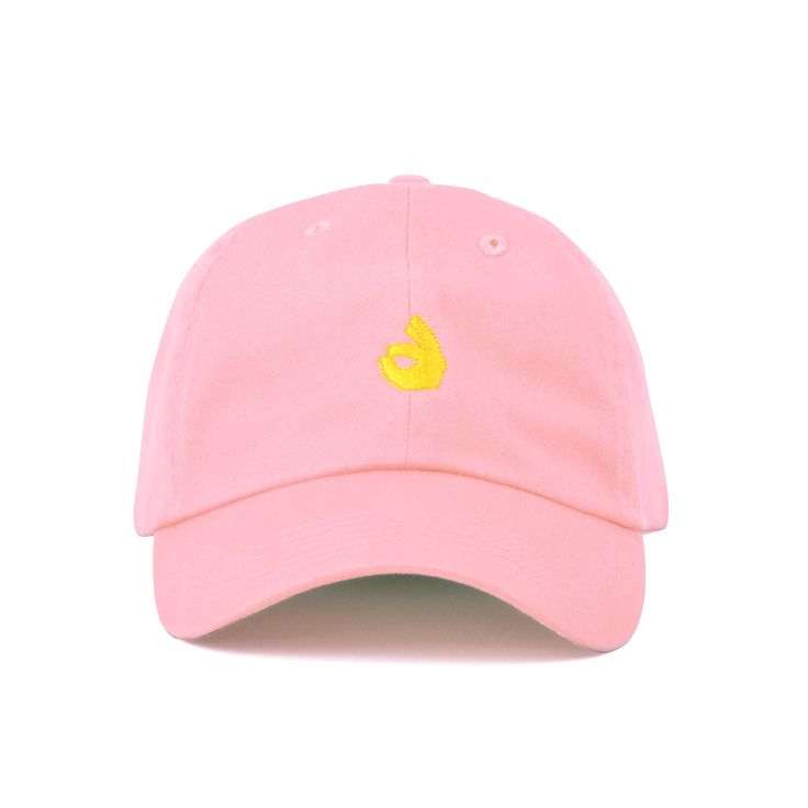 A 100% soft cotton strapback hat, with low profile build and metal buckle. Featuring the OK Hand emoji embroidery. Offered in Black or Pink colorways.