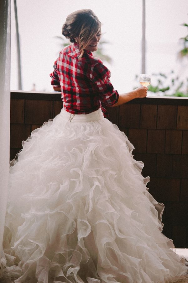 The bride donned a plaid flannel shirt over her gown while she prepped for the wedding. |   Photo by Lisa Fitts Photography, Bride's Gown by Mori Lee from Prevue Formal and Bridal