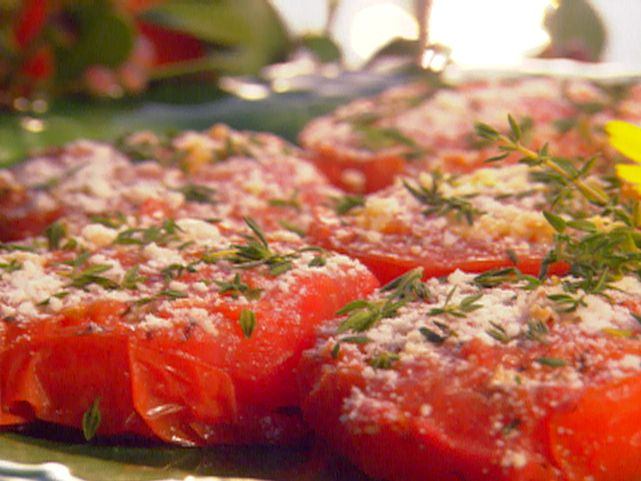 My mom tried these and assure me the recipe is a keeper. Perfect for summer-- Garlic Grilled Tomatoes from FoodNetwork.com