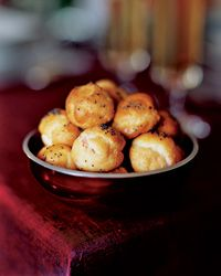 These smoked salmon puffs are like a cheesy gougere made with pate a choux - bake the shells in advance and freeze so you don't miss kickoff. Found here: http://www.foodandwine.com/recipes/smoked-salmon-stuffed-puffs
