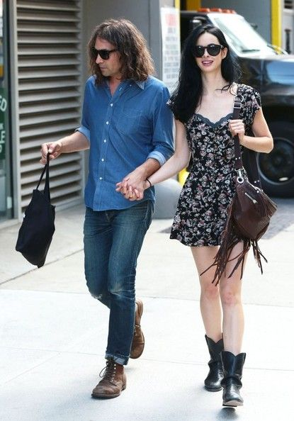 Adam Granduciel holding hands with girlfriend Krysten Ritter.  She'd better be good to him!