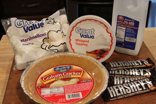 hershey bar pie~4 hershey's milk chocolate with almonds bars (1.45 oz each) 2/3 cup milk 20 large marshmallows   12 oz container of cool whip, divided   1 graham cracker pie crust
