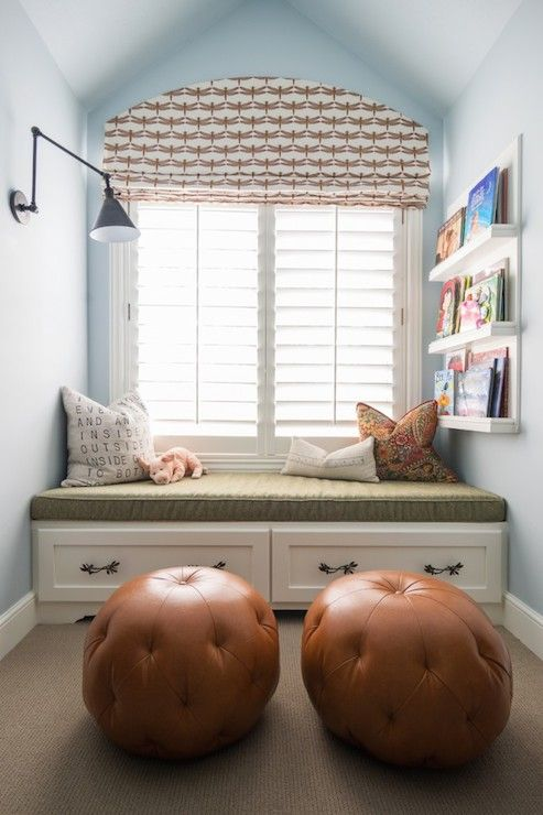 Cozy kids' reading nook features storage window seat topped with an army green seat cushion and ...