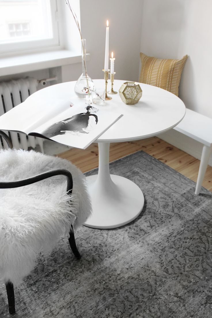 love the clean, simple white table. also, the bench is nice because it doesn't take up too much space, but provides 2 extra seats! we could even get a bench that has extra storage inside it :) SEES