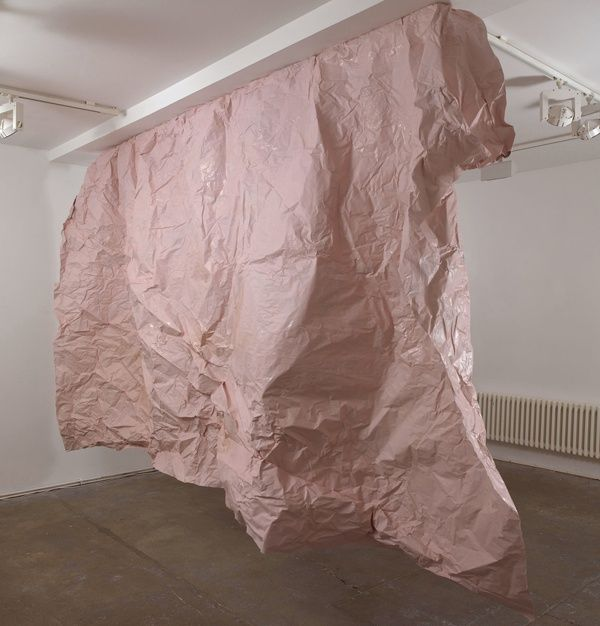 Karla Black, What Others Ask, 2008, Brown paper, paint, glue, eyeshadow, lipstick, nail varnish, wood, 222 x 370 x 58 cm, Installationview West London Projects, Courtesy of the artist, Mary Mary, Glasgow and Galerie Gisela Capitain, Köln.