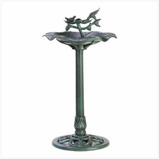 $39.95 - Distressed finish gives this handsome metalwork birdbath the appearance of a well-weathered antique.