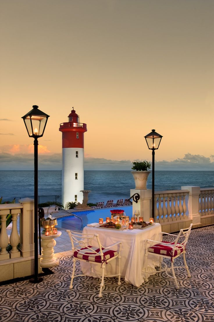 Experience gorgeous sunsets and first-class food at the Oyster Box Hotel, Umhlanga Rocks, South Africa.