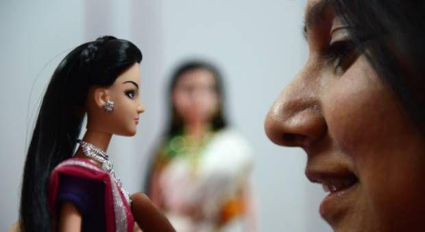 "Indian fashion designer, Hima Sailaja Theerdhala poses with her self-designed Indian fashion doll ""Kiyaa"" at her Shel design studio in Hyderabad."