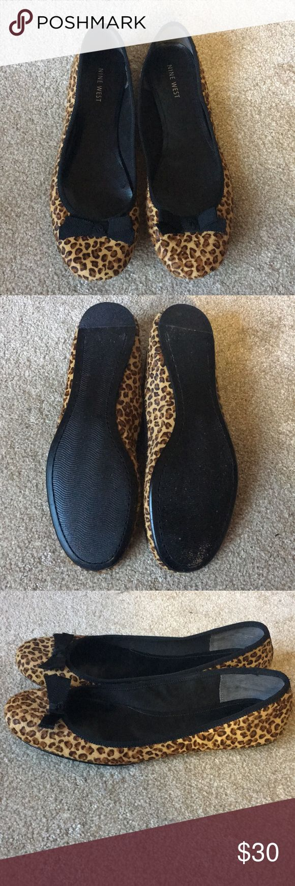 Nine West flats Rarely worn like new shoe. real fur cheetah print flats. Black bow on the front. Nine West Shoes Flats & Loafers