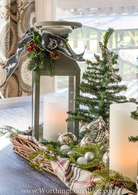 How To Decorate With Lanterns - tie a sprig of faux greenery and pinecones with pretty ribbon for a charming Christmas lantern