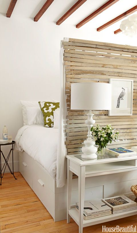 """Lathe walls enclose the sleeping area in a 400-square-foot Brooklyn apartment. """"Inside, it's hung with white curtains,"""" Lyndsay Caleo of The Brooklyn Home Company says. """"It's incredibly cozy, like you're in a nest, a cocoon, but it's still light and airy."""" The Brimnes bed from Ikea has drawers underneath, for more storage. """"We decided to define a sleeping area, because we felt people needed a private space,"""" says design partner Fitzhugh Karol."""