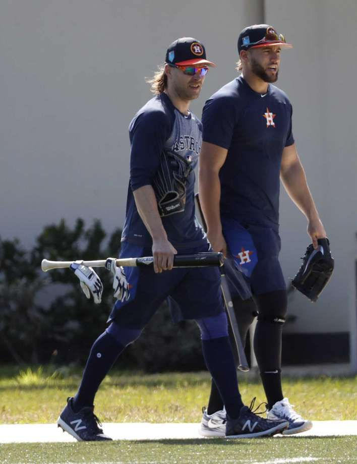 25a68c254 Houston Astros outfielders Josh Reddick and George Springer walks back to  the clubhouse after a workout with other early arriving position players  during ...